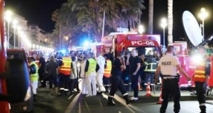 "Police officers, firefighters and rescue workers are seen at the site of an attack on July 15, 2016, after a truck drove into a crowd watching a fireworks display in the French Riviera town of Nice. A truck ploughed into a crowd in the French resort of Nice on July 14, leaving at least 60 dead and scores injured in an ""attack"" after a Bastille Day fireworks display, prosecutors said on July 15.  / AFP PHOTO / Valery HACHE"